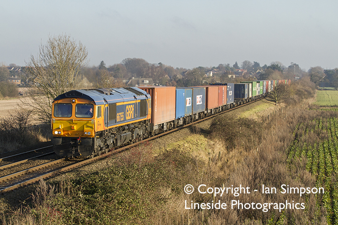 GBRf Class 66 66755 climbs away from Thurston with 4M29 10.29 Felixstowe North to Birch Coppice on Wednesday 28th December.