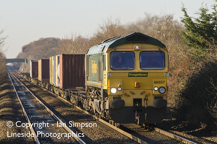 Freightliner's diverted 4L89 22.01 Coatbridge to Felixstowe coasts downhill through Thurston station as it makes its way towards Ipswich on Thursday 29th December 2016.
