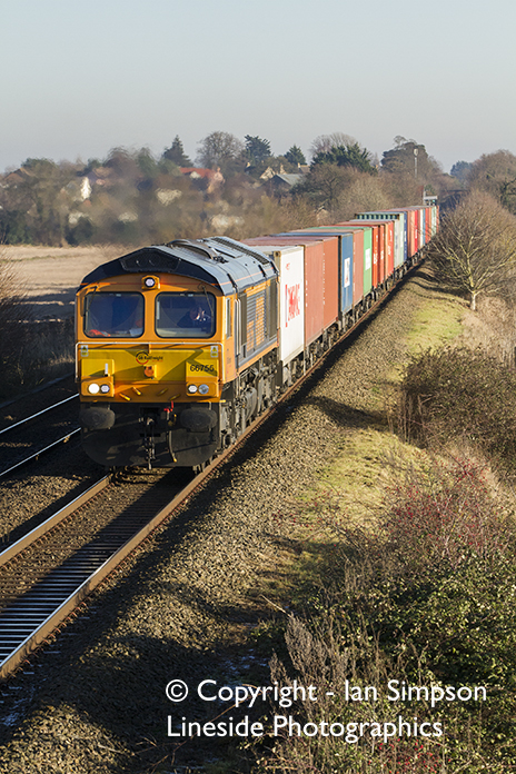 One of many diversions, GBRf Class 66 66755 climbs away from Thurston with 4M29 10.29 Felixstowe North to Birch Coppice on Thursday 29th December.