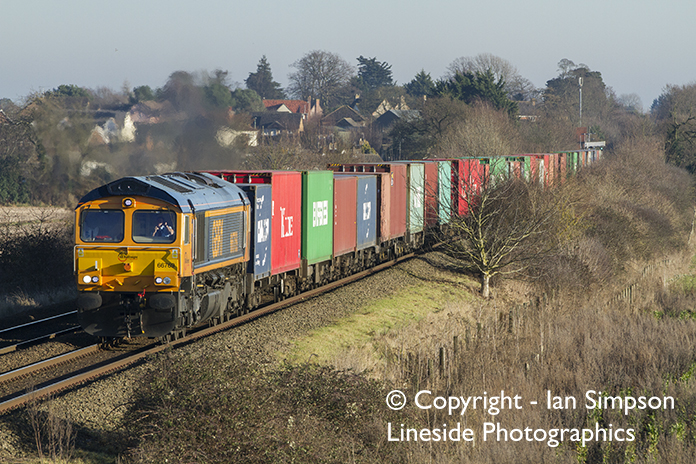 GBRf Class 66 66769 climbs away from Thurston with the 4M23 11.22 Felixstowe North to Doncaster Railport on Thursday 29th December.