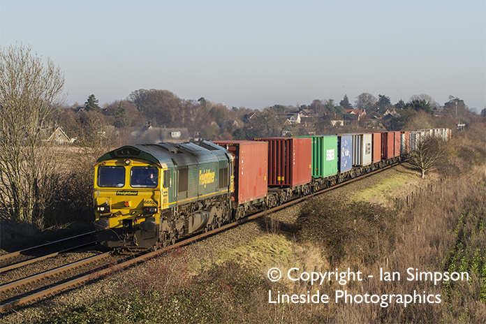 Freightliner Class 70 70016 climbs away from Thurston with the diverted 4M87 11.13 Felixstowe to Trafford Park on Thursday 29th December.