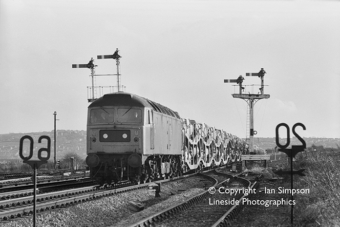 An unidentified Class 47 powers a fully loaded car transporter train at an unknown location. Nice photo though!