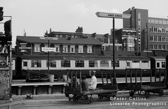 A smartly attired mother, or doting grandmother, has accompanied two boys to King's Cross for a bit of trainspotting and they are suitably ensconced on handy Post Office trollies whilst their airline bag, a common spotter's carry-all, sits on the platform. In the background one of the last two Gresley-designed Buffet Cars is at rest, marshalled into a Mark 2 set having arrived in the formation of an up express. The scene is vastly different now since electrification.