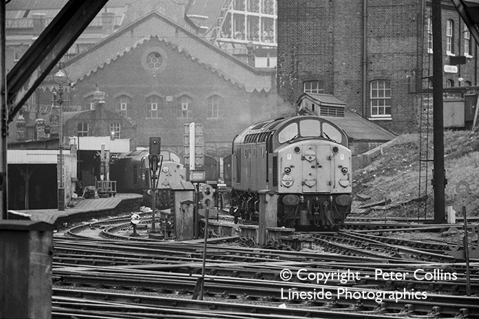 Two Class 40s (as yet unidentified) are performing the shunting manoeuvre required to get from the King's Cross fuelling point to the platform roads. The date is some time in 1973.