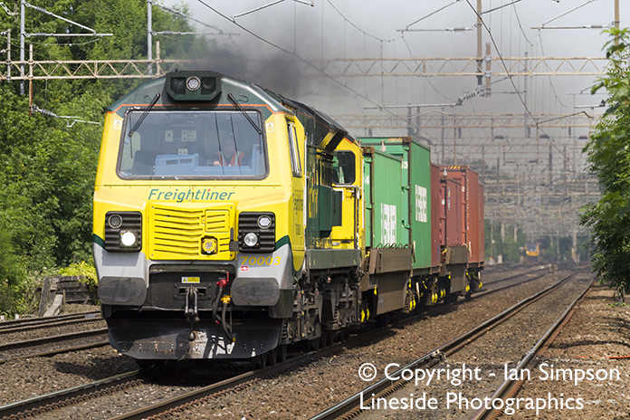 Freightliner 'Slug' (Class 70), 70003, heads through Heaton Chapel station on 19th June 2017 with a very short 4L90 (MO) 11.17 Trafford Park F.L.T to Felixstowe South F.L.T. service.