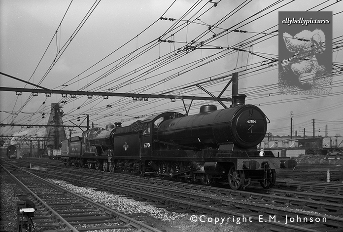 Robinson O4 63704 and Great Central D11 506 'Butler Henderson' is seen being shunted outside Gorton works on 24th July 1963.
